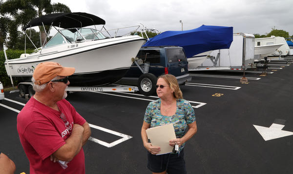 fl-cooper-city-storage-lots-rate-increase05c----Cooper City residents Jeff Gambill and Helen Graham say the city doubled the rates for residents renting a boat or RV space at the city-owned storage lots. Carline Jean, Sun Sentinel