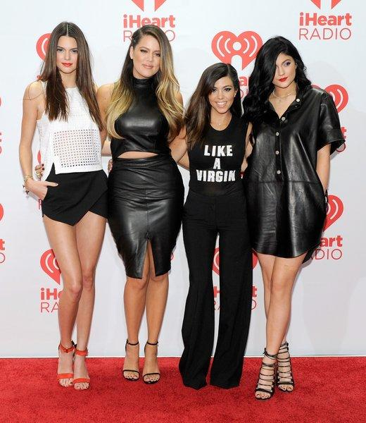 From left, sisters Kendall Jenner, Khloe Kardashian, Kourtney Kardashian and Kylie Jenner at the iHeartRadio Music Festival in September; Kendall and Kylie Jenner will be at the Glendale Galleria on Friday.