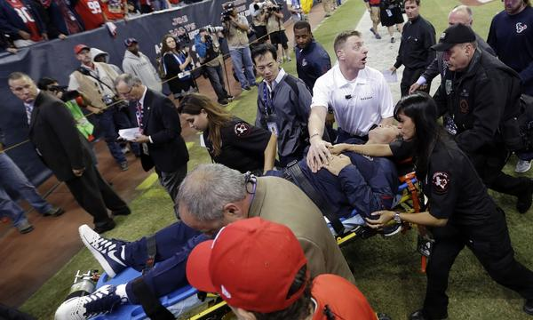 Houston Texans Coach Gary Kubiak is taken off the field on a stretcher by medical personnel during Monday's game against the Indianapolis Colts. NFL coaches are under almost constant pressure to succeed.