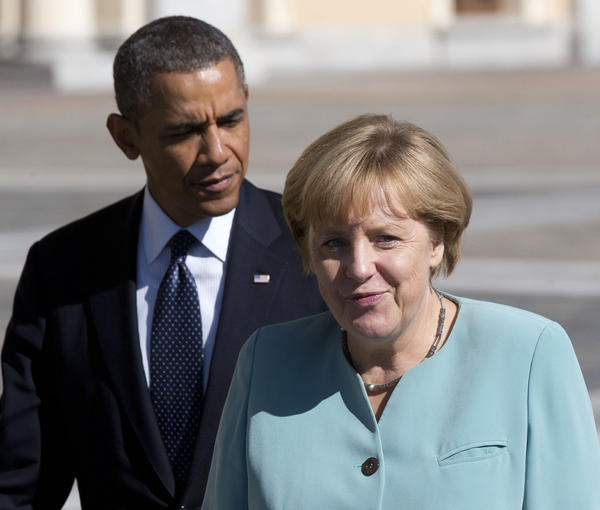 President Obama is seen walking with Germany's Chancellor Angela Merkel toward a group photo outside of the Konstantin Palace in St. Petersburg.