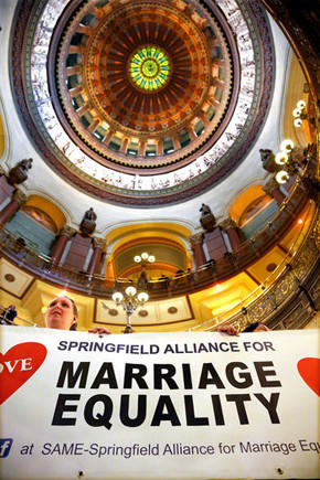 Supporters of same sex marriage legislation rally in the rotunda at the Illinois State Capitol on Tuesday, Nov. 5, 2013 in Springfield Ill.
