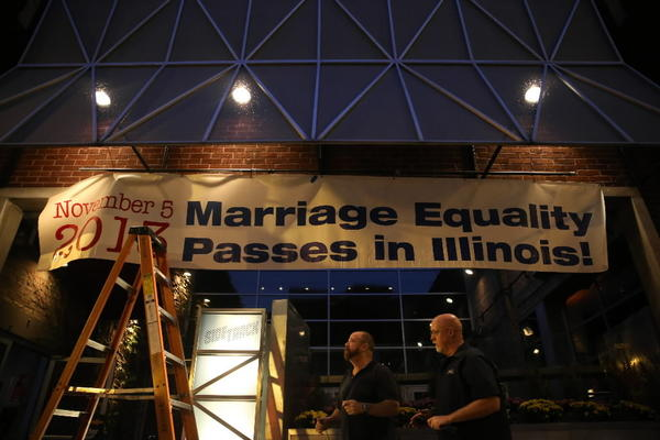 A celebratory banner is hung Tuesday in front of Sidetrack in Boystown.