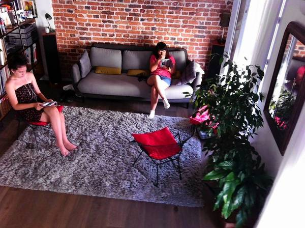 Hannah, left, and Nancy MacDonald relax in the home-swap apartment, an exchange that made a stay in Paris affordable.