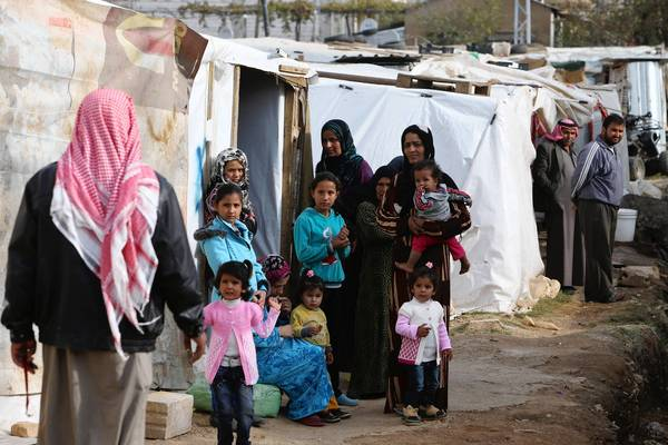 Syrian refugees at a camp in Delhamiyeh, Lebanon, are among the estimated 2 million who have fled the war in Syria. Meanwhile, more than 9 million who remain in the country are in dire need of aid as winter approaches, the United Nations says.