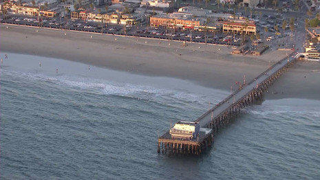 Authorities say a passenger jumped from tour helicopter and fell 500 feet to his death near the Balboa Pier.
