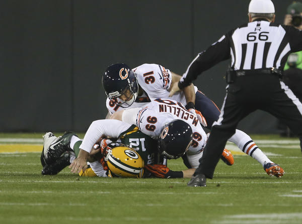Bears defensive end Shea McClellin (99) smothers Green Bay Packers quarterback Aaron Rodgers (12) after sacking him.