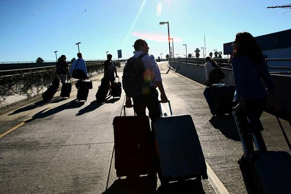 "Travelers make their way toward LAX. ""It was like a science fiction movie, like the 'Day the World Ended,' "" one traveler said."