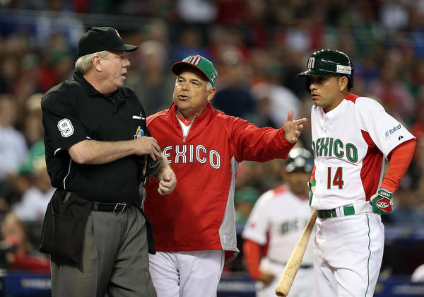 Manager Rick Renteria of Mexico argues with home plate umpire Brian Gorman during the World Baseball Classic.