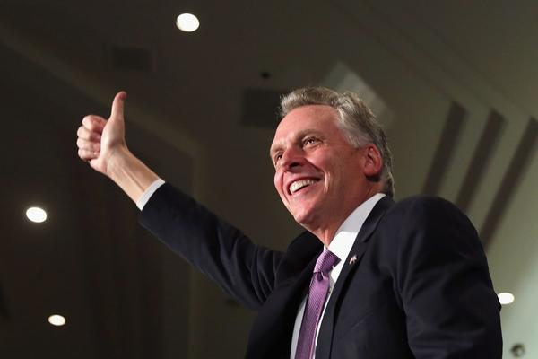 Democrat Terry McAuliffe celebrates winning the Virginia governorship at an election night party in Tysons Corner, Va.