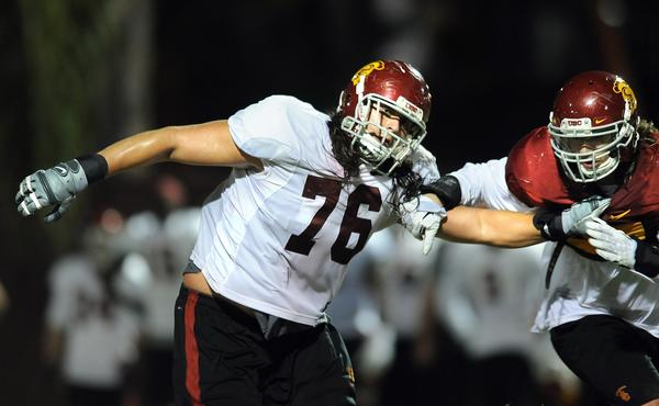 USC offensive tackle Nate Guertler hasn't let his walk-on status prevent him from being a hero to his younger brother.