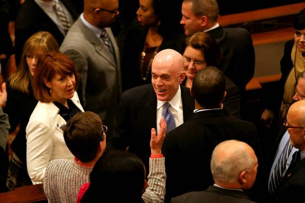 State Rep. Greg Harris, D-Chicago, is congratulated Tuesday after the Illinois House voted to approve a gay marriage bill he sponsored.