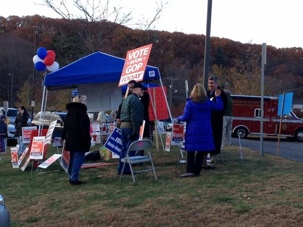 Mark Zacchio and Heather Maguire, at left, with other Republicans outside the polling station at Avon High School on Tuesday. Both won seats on the town council in a Republican sweep of elected government panels in Tuesday's election in Avon.