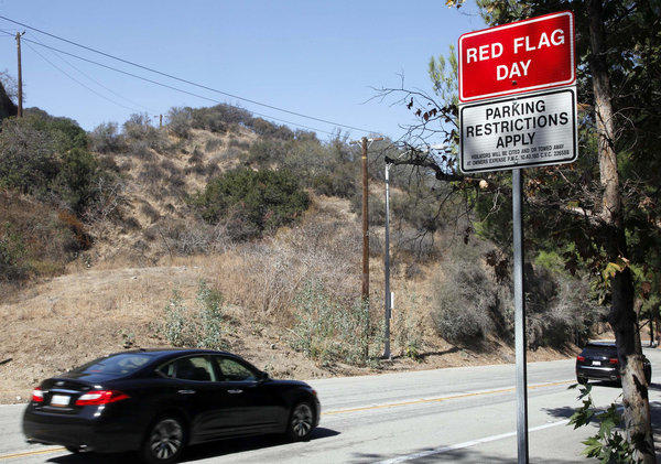 A red flag fire warning sign, advising hot and dry weather conditions, was posted in Pasadena.