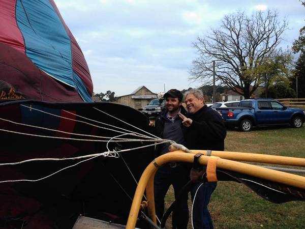 Filmmaker Jeff Boedeker, left, and Newport News balloonist Mark Nelson pose just before taking a flight over Smithfield Tuesday, Nov. 5, 2013.