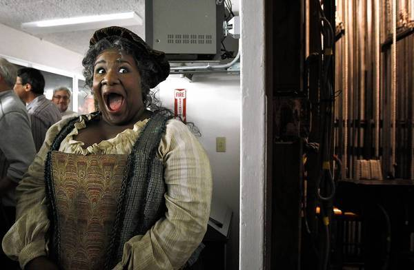 "Ronnita Nicole Miller, cast as Mistress Quickly in L.A. Opera's staging of ""Falstaff,"" shares a laugh backstage at the Dorothy Chandler Pavillion."