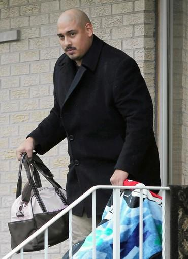 "Chicago police Officer Gildardo Sierra, pictured in 2011 leaving his home with his baby, admitted to drinking ""multiple beers"" before coming to work the night he shot and killed Flint Farmer."