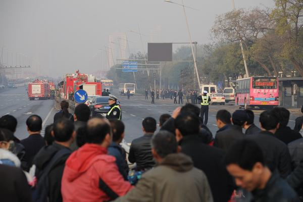 Police and emergency workers block off an area rocked by explosions in Taiyuan, China, on Wednesday.