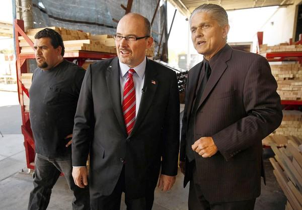 GOP Assemblyman Tim Donnelly, center, gets a tour of the Darafeev furniture factory in Baldwin Park from owner Paul Darafeev, right. Donnelly announced that he is running for governor.