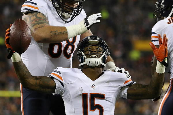 The Bears' Brandon Marshall (15) celebrates with teammate Matt Slauson (68) after catching a touchdown during the Bears-Green Bay Packers game Nov. 4, 2013 at Lambeau Field in Green Bay, Wis.