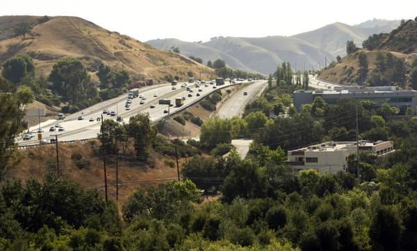 Urban wildlife specialists recommend building a tunnel under the 101 Freeway to provide safe passage for mountain lions, bobcats and other animals. Above, the 101 at Liberty Canyon.