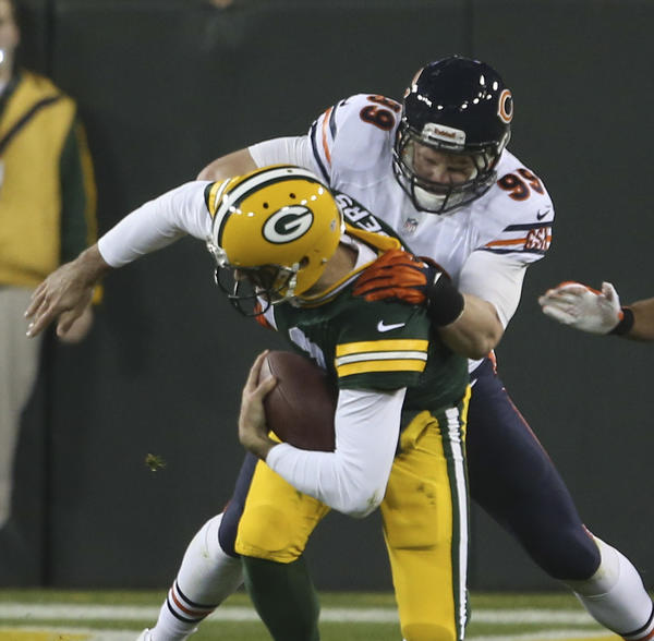 Bears defensive end Shea McClellin (99) sacks Packers quarterback Aaron Rodgers.