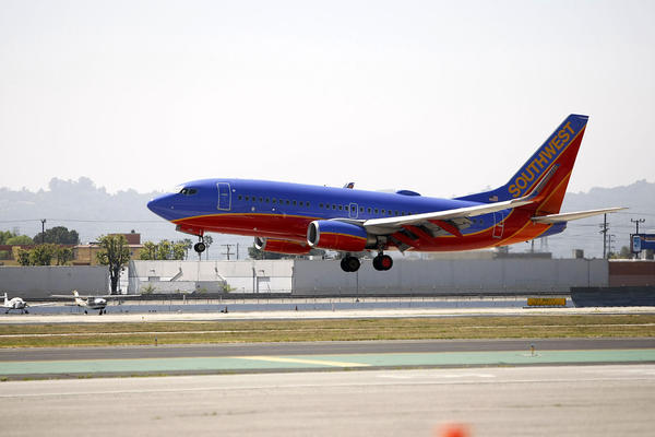 A Southwest Airlines plane lands at the Burbank Airport on Saturday, March 23, 2013.