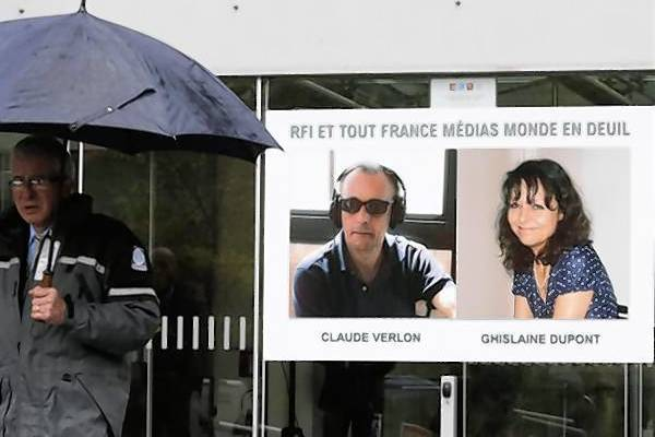 A poster with the portraits of reporter Ghislaine Dupont and radio technician Claude Verlon is seen at the entrance of Radio France Internationale building near Paris.