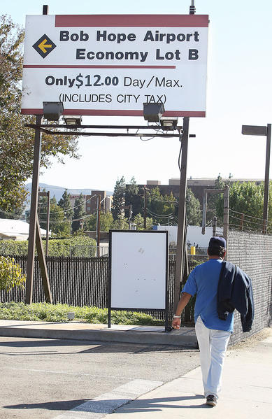 A pedestrian walks by Lot B at the Bob Hope Airport on Tuesday, Nov. 4, 2013.