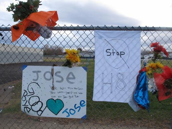 Friends have added a message to Jose Reyes and a small wooden cross at a memorial outside Sparks Middle School, where the seventh-grader fatally shot a teacher and wounded two 12-year-old classmates before killing himself in the schoolyard a week ago.