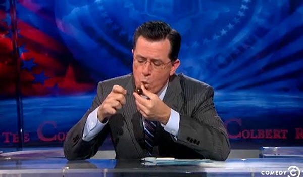 "Stephen Colbert fires up his crack pipe on ""The Colbert Report."""