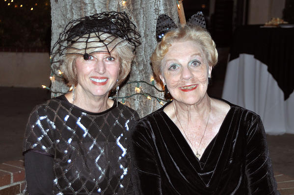 Gracella Gibbs and Lorie MacKenzie, dressed for the Halloween season, were chairs of the Thursday Club's Casino Night.