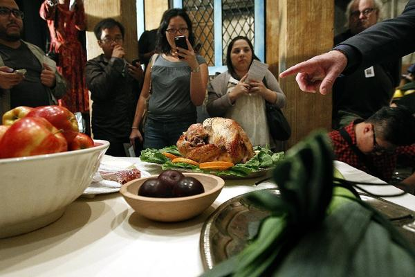 "Reporters surround a turkey feast staged backstage at the L.A. Opera before a rehearsal of ""Falstaff"" at the Dorothy Chandler Pavilion in downtown Los Angeles."