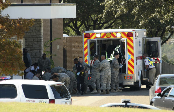 In this Nov. 5, 2009, file photo, released by the U.S. Army, the wounded are prepared for transport outside the Soldier Readiness Processing Center at Ft. Hood, Texas, where a gunman killed 13 people and wounded more than 30.