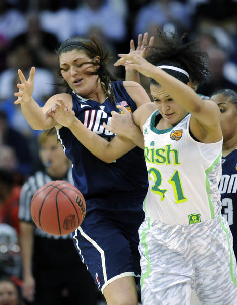 Connecticut Huskies center Stefanie Dolson (31) strips the ball from Notre Dame Fighting Irish guard Kayla McBride (21) during the first half of the women's NCAA semifinal in New Orleans, Louisiana. UConn won, 83-65. (Cloe Poisson/Hartford Courant/MCT) ORG XMIT: 1137220