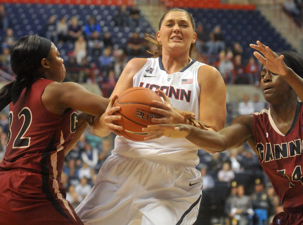 Storrs - 11/01/13 - UConn's Stefanie Dolson drives between Gannon players Doriyon Glass, left, and Lanise Saunders at Gampel Pavilion Friday night. BRAD HORRIGAN | bhorrigan@courant.com
