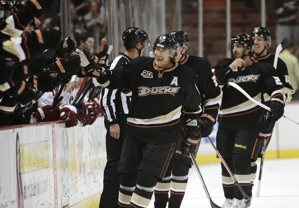 Ducks forward Teemu Selanne, center, celebrates after scoring a goal during a win over the Phoenix Coyotes on Oct. 18.
