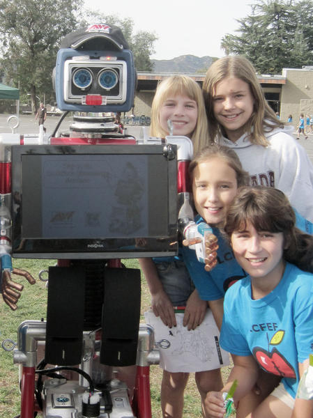Allied Waste Recycling Robot, MRFY, with Emily Weirick, Emilie Risha, Danyelle Whisnett, and Claire Fausett. Allied Waste is a presenting sponsor of La Canada Flintridge Educational Foundation's Jog-A-Thon on Nov. 13.
