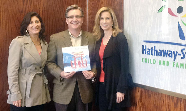 Hathaway-Sycamores' board members Renee LaBran, Scott Hodgkins and Jennifer Le Blanc with the 2014 Children's Art Calendar.