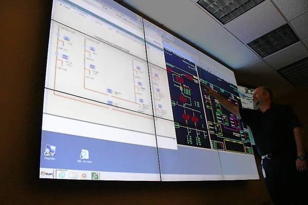 Senior system operator Tony Utsler helps monitor electric utility activity in Leesburg.
