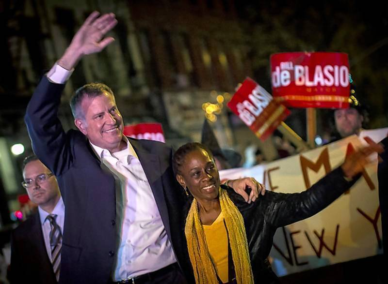Bill de Blasio and his wife Chirlane McCray greet spectators during the Park Slope Halloween Parade in the Brooklyn borough of New York.