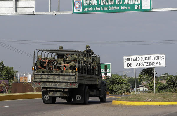 An army convoy enters Apatzingan in Michoacan state, Mexico. The city is near Lazaro Cardenas, where Mexico's military has taken control of one of the nation's busiest seaports as part of its effort to bring drug cartel activity under control.