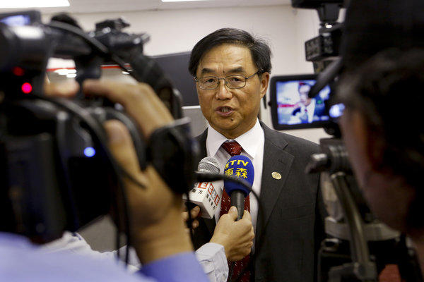 Hacienda La Puente school board member Joseph Chang answers questions at a news conference in September.