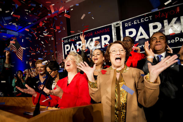 Houston Mayor Annise Parker, center, celebrates her election victory with her partner, Kathy Hubbard, right, during a campaign party at the George R. Brown Convention Center in Houston.
