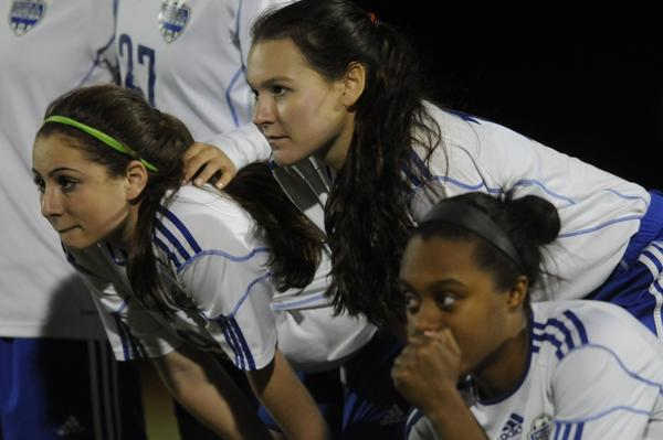 (L to R) Sophia Pascon, Hannah Merritt and Allyson Swaby realize their soccer season just ended on penalty kicks against Ludlowe-Fairfield Wednesday night during the CIAC tournament game.