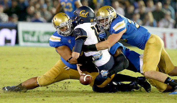 UCLA defensive end Eddie Vanderdoes, left and linebacker Jordan Zumwalt, right, sack California quarterback Jared Goff during the Bruins' 37-10 win over the Golden Bears at the Rose Bowl on Oct. 12.