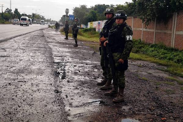 "Mexican troops are among the federal forces who have taken over control of Lazaro Cardenas port from municipal police. A government spokesman said officials had received tips about ""acts of corruption"" and collusion with drug cartels."
