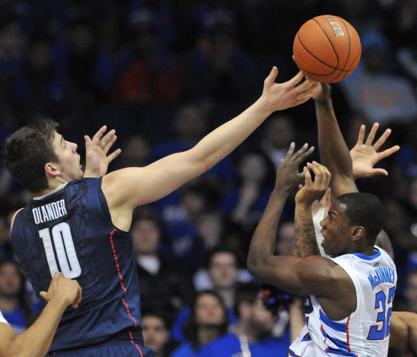 Rosemont, IL - 02/23/13 - UConn's Tyler Olander defends DePaul's Charles McKinney at the Allstate Arena Saturday night. BRAD HORRIGAN | bhorrigan@courant.com