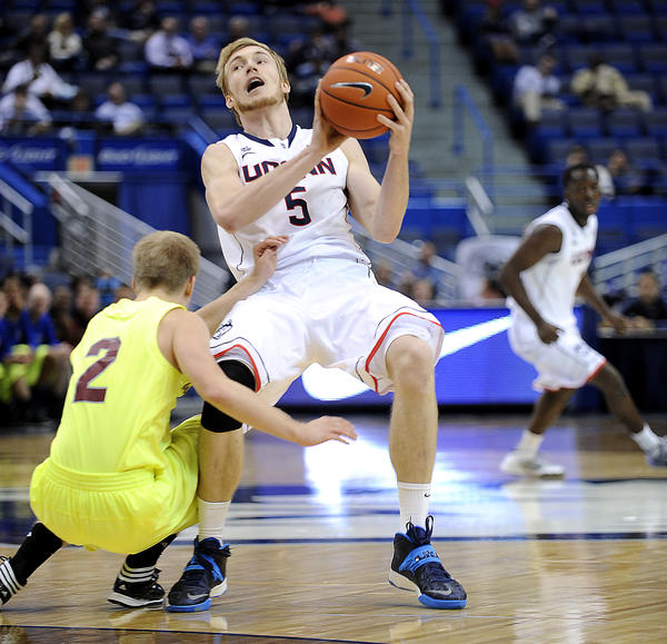 Hartford, CT 11/04/13 Connecticut's Niels Giffey is fouled by Joel Kosberg of Concordia during the second half. Giffey scored 12 points as the Huskies rolled to a 98-38 victory. Photo by JOHN WOIKE | woike@courant.com hc-photo-uconn-men-1105