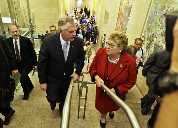 Virginia Gov.-elect Terry McAuliffe talks with the clerk of the state Senate, Susan Schaar, at the Capitol in Richmond after a news conference to announce his transition team.