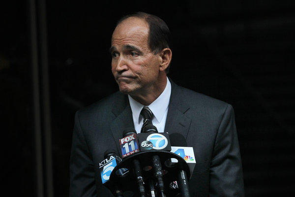 The former police chief of Bell, Randy Adams, talks to the media after testifying as a defense witness in the trial of Angela Spaccia, the former Bell official who hired him in 2009. Adams was once among the highest-paid law enforcement officials in the nation for policing the small city in southeast Los Angeles County.